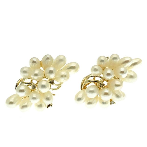 vintage gouden oorstekers met parel en diamant