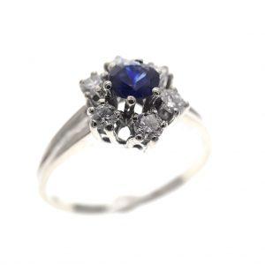 witgouden entourage ring diamant saffier