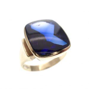 gouden Elvis ring blauwe steen