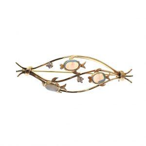 gouden broche vissen