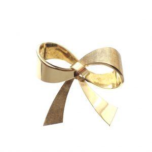 gouden broche als strik